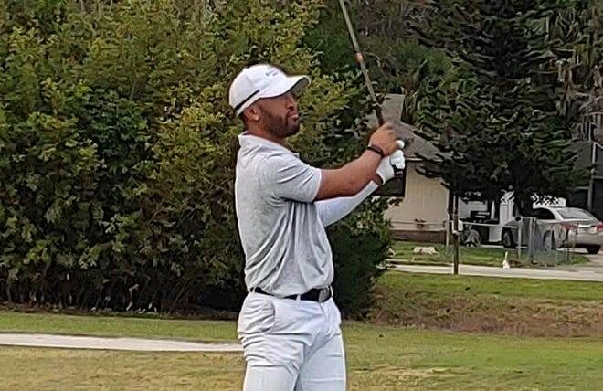 Willie Mack III watches his tee shot on the par-4 18th hole Sunday at Riviera.