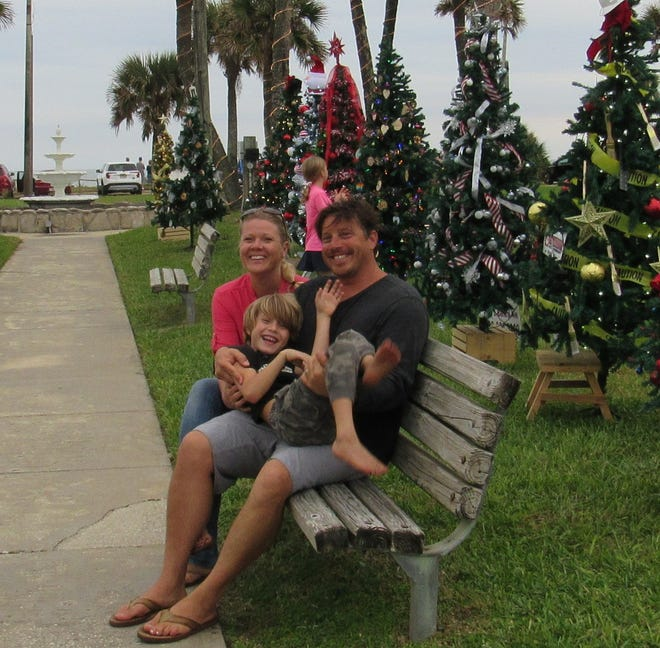 Nick Kimball and his family donated 20 artificial trees to be decorated by local businesses for the public to enjoy as part of the inaugural Starry Nights in Flagler Beach celebration, which kicked off Friday evening. Pictured: Robin Kimball, Nick Kimball, Oliver Kimball.