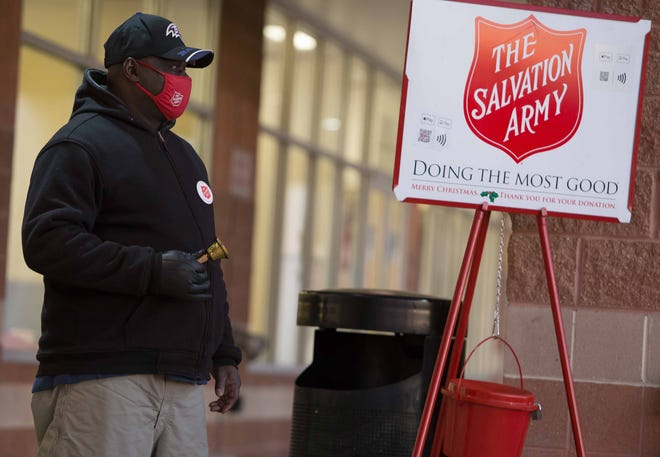 Salvation Army volunteer Bernard Tingle, of Dover, rings a bell near the red kettle at Safeway in Dover on Dec. 2.