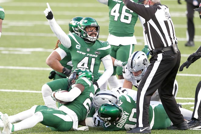 New York Jet Matthias Farley (41) reacts after a fumble recovery during the second half of Sunday's game against the Las Vegas Raiders.