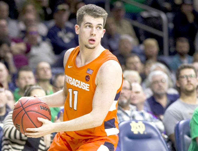 Syracuse's Joseph Girard III holds the ball during a Jan. 22 game against Notre Dame in South Bend, Indiana. Girard had 21 points and a career-high six of the Orange's school record-tying 15 three-pointers in Saturday's win over Rider.