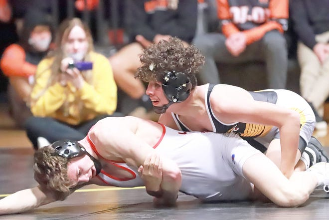 Marcel Lopez of New London (top) beat Lisbon's Cade Siebrecht, 9-1, on his way to winning the 126-pound title at Saturday's Jeremy Fulk Classic at New London.