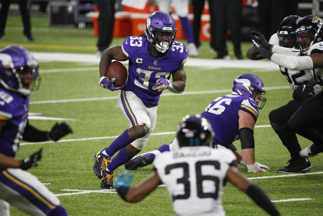 Minnesota running back Dalvin Cook carries the ball in overtime on Sunday during the Vikings' game against the Jaguars. Cook carried the ball eight times in a row in overtime to set up the winning field goal by Dan Bailey.