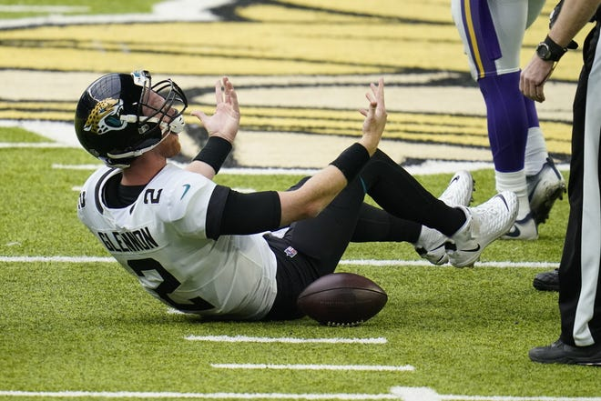 Jaguars quarterback Mike Glennon reacts after being sacked during the second half of an NFL football game against the Vikings  Sunday.
