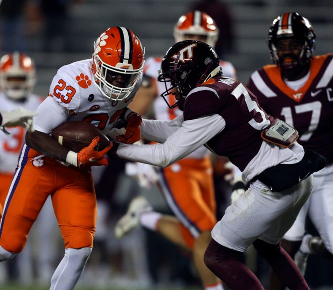 Clemson's 23 Lyn-J Dixon gets past Virginia Tech's 37 Brion Murray for a touchdown in the second quarter of the Virginia Tech - Clemson NCAA college football game in Blacksburg Va. Saturday December 5 2020.  (AP Photo /  MATT GENRTY, The Roanoke Times, Pool)