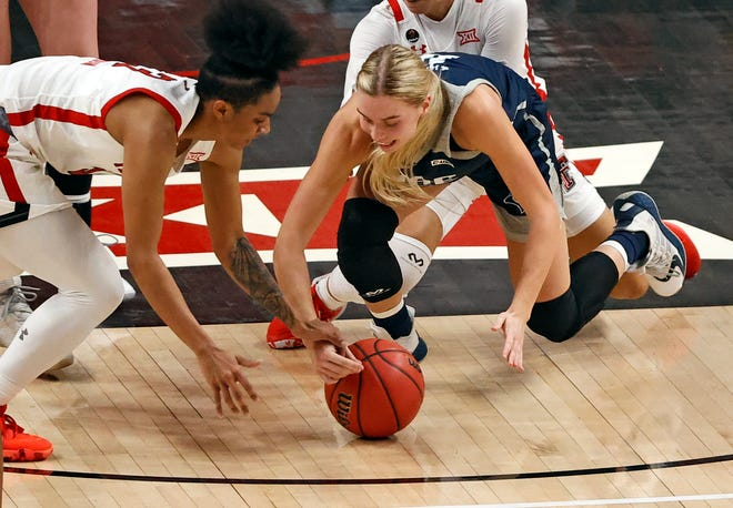 Texas Tech's Maka Jackson (3) and Rice's Haylee Swayze (11) dive for the loose ball during a non-conference women's basketball game on Saturday at United Supermarkets Arena.
