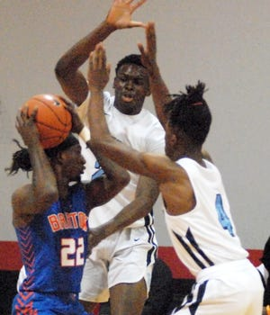 Bartow's Daithan Davis (22) tries to pass around Dr. Phillips' Ernest Udeh (back) and Jordan Tillery (4) during the first half of the Breast Cancer Awareness Classic.