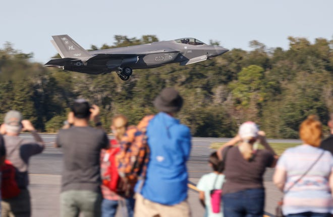 An F-35 Lightning II takes off for a demonstration flight at the  Holiday Flying Festival and Car Show at Sun 'n Fun in December 2020.