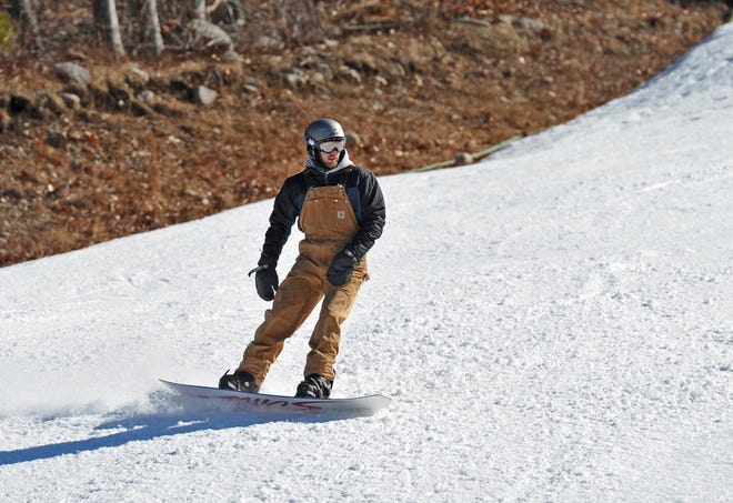 A snowboarder is shown heading downhill at the Blue Hills Ski Area in Canton in Saturday, Feb. 9, 2020.