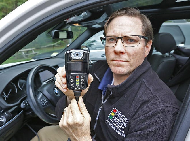 In this 2019 file photo, Matt Wendel, field operations manager for Smart Start in Rockland,  demonstrates an interlock device for vehicles.