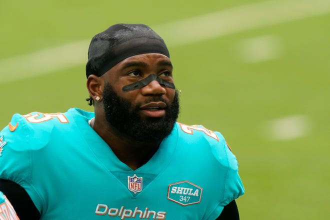 Miami Dolphins cornerback Xavien Howard (25) warms up before an NFL football game against the Cincinnati Bengals, Sunday, Dec. 6, 2020, in Miami Gardens, Fla.