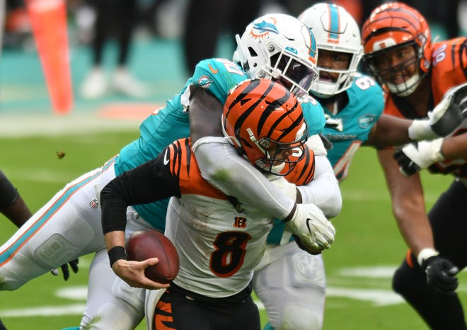 Dolphins outside linebacker Shaq Lawson sacks Bengals quarterback Brandon Allen during the fourth quarter of Sunday's game. Lawson had 2 sacks during Miami's win.