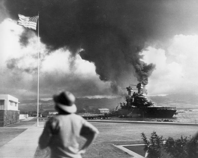 FILE - American ships burn during the Japanese attack on Pearl Harbor, Hawaii, in this Dec. 7, 1941 file photo. The coronavirus pandemic is preventing Pearl Harbor survivors from attending an annual ceremony to remember those killed in the 1941 attack. The National Park Service and Navy also are closing the ceremony to the public and livestreaming it instead. (AP Photo, File) ORG XMIT: FX403