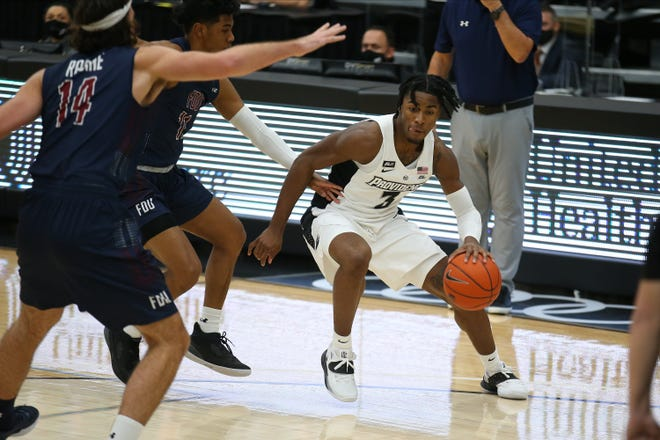 Providence College's David Duke, right, was the key in the second half, helping the Friars run away with a 79-67 win over Fairleigh Dickinson on Saturday.