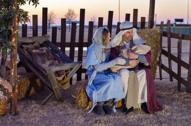 Mary and Joseph sit together at the live nativity hosted by The Church of Latter Day Saints in Prosper.