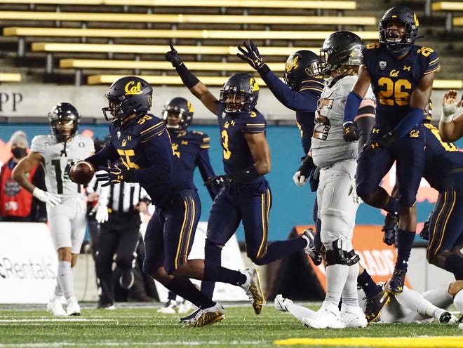 California linebacker Muelu Iosefa celebrates after recovering a fumble on Oregon's last offensive possession of the game on Saturday. California won 21-17.