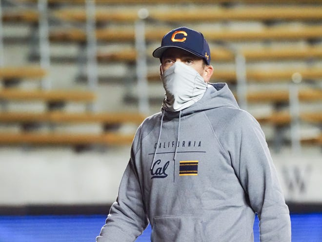 California coach Justin Wilcox leaves the field at halftime of Saturday's game in Berkeley. He later walked off the field a winner over Oregon for the first time in four tries as the Golden Bears' coach.