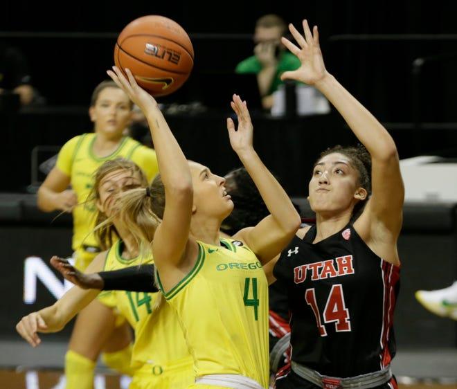 Oregon's Jaz Shelley shots against Utah's Niyah Becker during the second half.