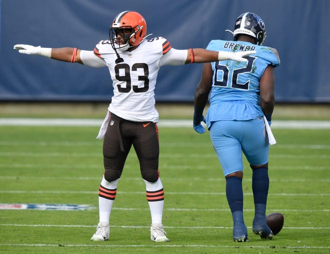 Browns middle linebacker B.J. Goodson (93) reacts to breaking up a pass intended for Titans center Daniel Munyer during the first quarter Sunday, Dec. 6, 2020 in Nashville, Tenn.  Aab9866