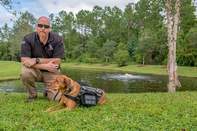 Greg Wells, a retired U.S. Army veteran, and his service dog, Utah. Wells said there is no way he could fly or be in other public situations without Utah by his side.