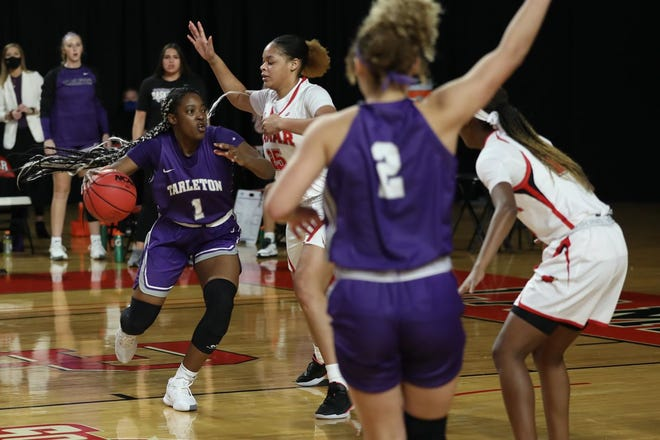 Tarleton's Lucy Benson (No. 1), left, drives the ball against a Lamar defender as Iyana Dorsey (No. 2) looks for the pass during the Texans 73-58 loss on Saturday at the Montagne Center in Beaumont.