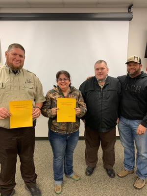 "Lt. James Robison, right, and Lt. Danny Clayton of the Erath County Sheriff's office congratulated corrections officers Corrina Porter and James Dunbar with special commendations. Porter and Dunbar are transport officers for the department and ""have been doing an amazing job."""