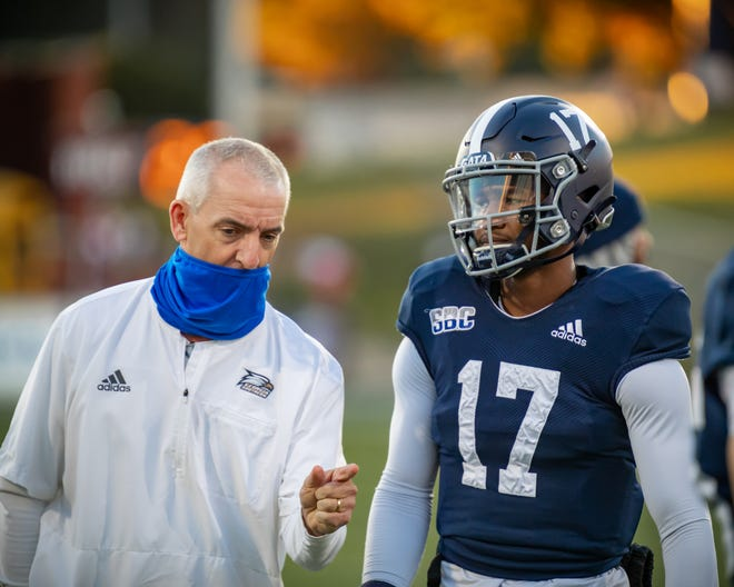 Georgia Southern's Doug Ruse, then the interim offensive coordinator and quarterbacks coach, talks with starting quarterback Justin Tomlin (17) on Dec. 5, 2020, during a game against Florida Atlantic at Paulson Stadium in Statesboro.
