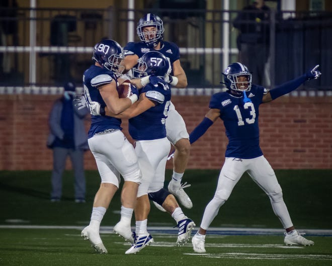 Georgia Southern teammates celebrate with nose tackle Parker Devine (90) after he recovered a fumble by Florida Atlantic on Saturday night, Dec. 5, at Paulson Stadium in Statesboro. [AJ HENDERSON/GEORGIA SOUTHERN ATHLETICS]