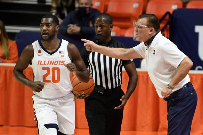 Illinois head coach Brad Underwood gives directions to Da'Monte Williams in the first half of an NCAA college basketball game against North Carolina A&T, Wednesday, Nov. 25, 2020, in Champaign.