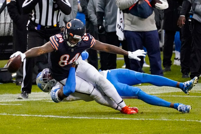 Bears wide receiver Cordarrelle Patterson (84) is tackled by Lions defensive back Tracy Walker (21) in the second half in Chicago, Sunday, Dec. 6, 2020.
