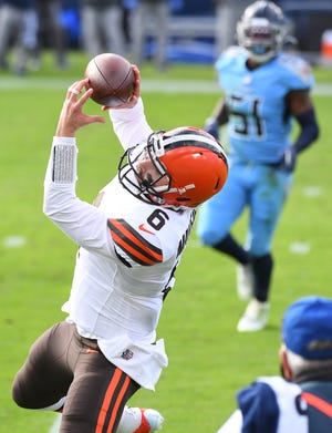 Browns quarterback Baker Mayfield catches a pass for a first down during the first half against the Titans on Sunday.