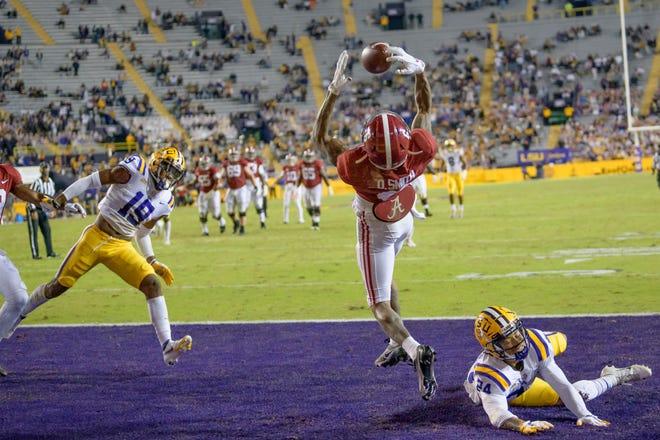 Alabama wide receiver DeVonta Smith makes a touchdown grab against LSU cornerback Derek Stingley Jr. during the first half of Saturday's game.