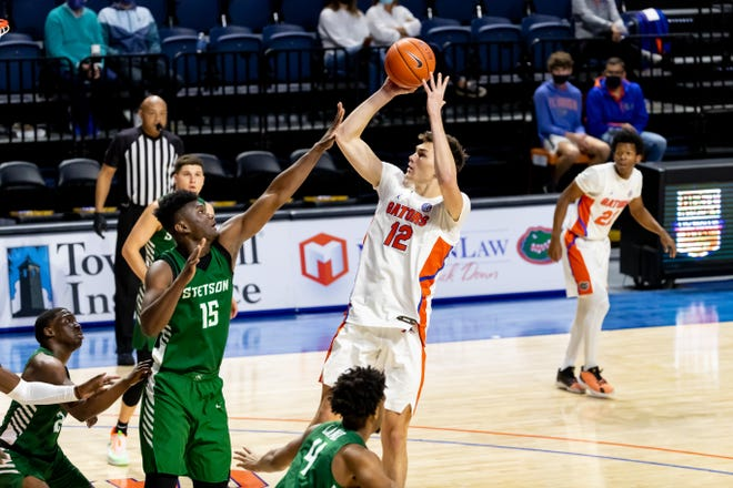 Florida forward Colin Castleton shoots a mid-range jumper in the first half Sunday against Stetson in Exactech Arena at the O'Connell Center.