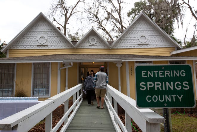 People enter the Springs County Welcome Center, established as part of an effort to split western Alachua County into an entirely new county, on Sunday in High Springs.
