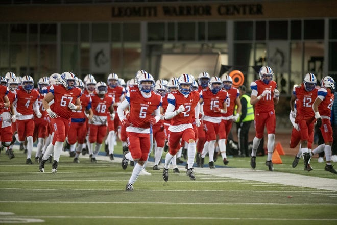 Cherry Creek football player Ky Oday Jr. (2) takes the field with the Bruins prior to the Class 5A championship game on Dec. 5, 2020. Oday Jr. has committed to CSU football.