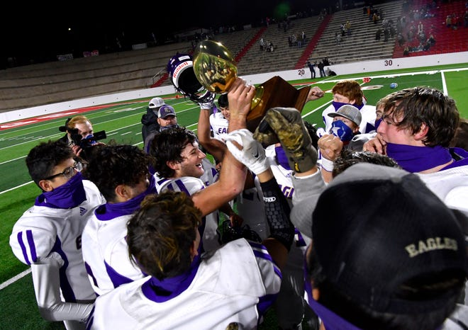 The Sterling City Eagles hoist the trophy after their victory over the Borden County Coyotes during Saturday's Class 1A Div. 1 state semi-final game at the Mustang Bowl in Sweetwater Dec. 5, 2020. Final score was 48-40, Sterling City.