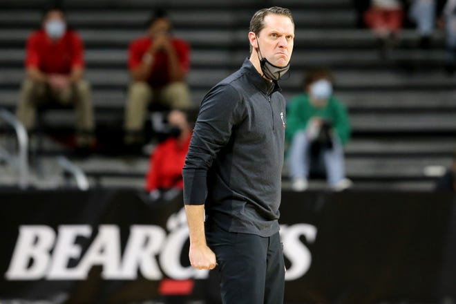 Cincinnati Bearcats men's basketball head coach John Brannen reacts after a foul call in the second half of the 88th Crosstown Shootout  college basketball game against the Xavier Musketeers at Fifth Third Arena in Cincinnati on Sunday, Dec. 6, 2020.