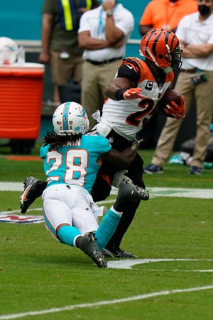Miami Dolphins strong safety Bobby McCain tackles Cincinnati Bengals running back Giovani Bernard on Sunday. Bernard hasn't been an impactful fantasy player in recent weeks, but he has a friendly matchup against the Cowboys this weekend.