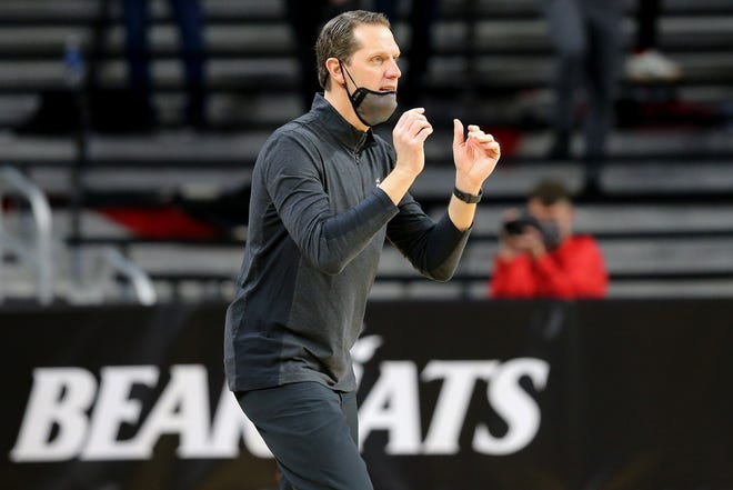 Cincinnati Bearcats head coach John Brannen instructs the team in the first half of the 88th Crosstown Shooutout NCAA college basketball game against the Xavier Musketeers, Sunday, Dec. 6, 2020, at Fifth Third Arena in Cincinnati.