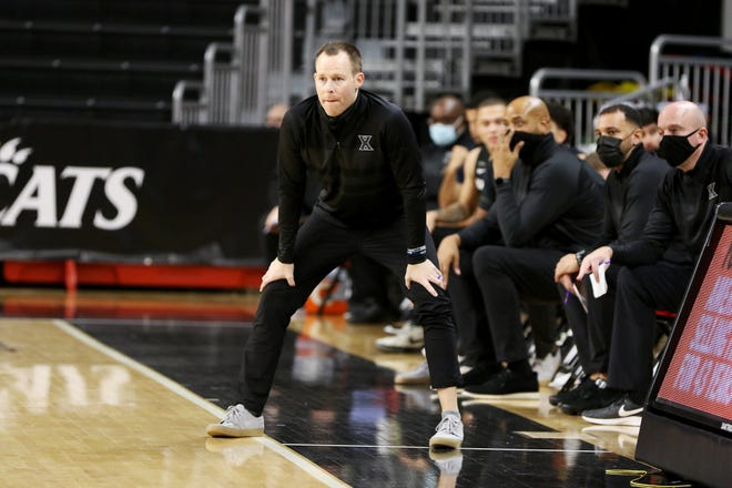 Xavier Musketeers head coach Travis Steele watches his team during the Crosstown Shootout at the Fifth Third Arena Sunday, December 6, 2020. The Musketeers won 77-69.