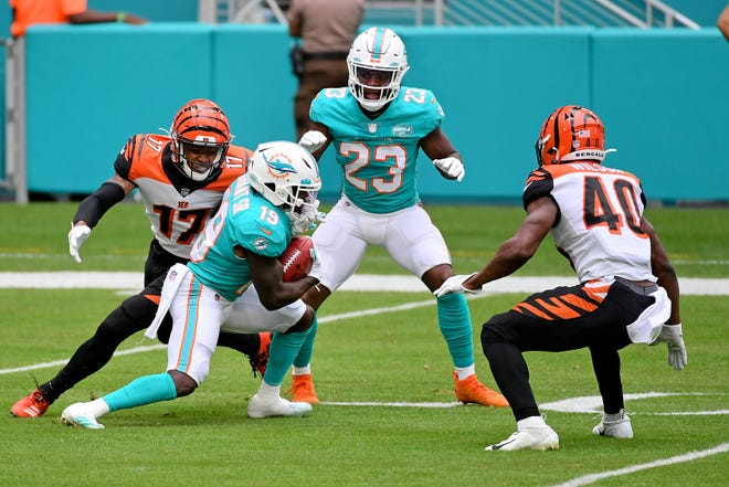 Dec 6, 2020; Miami Gardens, Florida, USA; Cincinnati Bengals wide receiver Stanley Morgan (17) tackles Miami Dolphins wide receiver Jakeem Grant (19) on the punt return during the first half at Hard Rock Stadium.