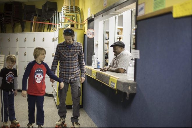 Tony Nolan, current owner of The Rink in Holland Township, smiles at customers Saturday, Dec. 27, 2015.