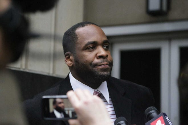 Former Detroit Mayor Kwame Kilpatrick exits the US Federal Courthouse in downtown Detroit on March 11, 2013, after the jury handed down a verdict in his public corruption trial. Kilpatrick was convicted on 24 of 30 counts, including five counts of extortion, racketeering, bribery and several mail, wire and tax fraud charges. On three counts he was found not guilty and on three there was no verdict reached.