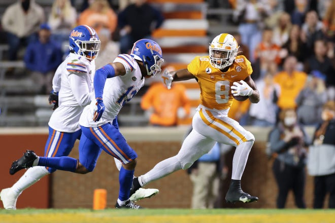 Tennessee running back Ty Chandler tries to get away from the Florida defense Saturday at Neyland Stadium.