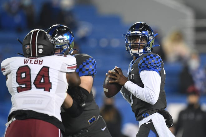 Kentucky quarterback Terry Wilson throws sparingly in the Wildcats' run-oriented offense.