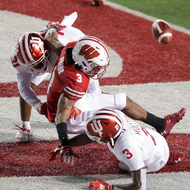 Indiana's Bryant Fitzgerald (31) and Tiawan Mullen break up a pass intended for Wisconsin's Kendric Pryor.