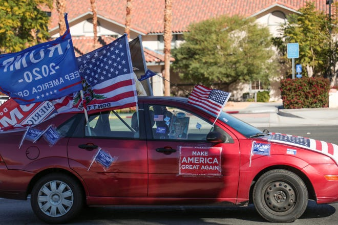 Audrey Ruttan drives her car in a 'Trump Brigade Parade' on Highway 111 in Rancho Mirage, Calif. on Sunday, December 6, 2020.