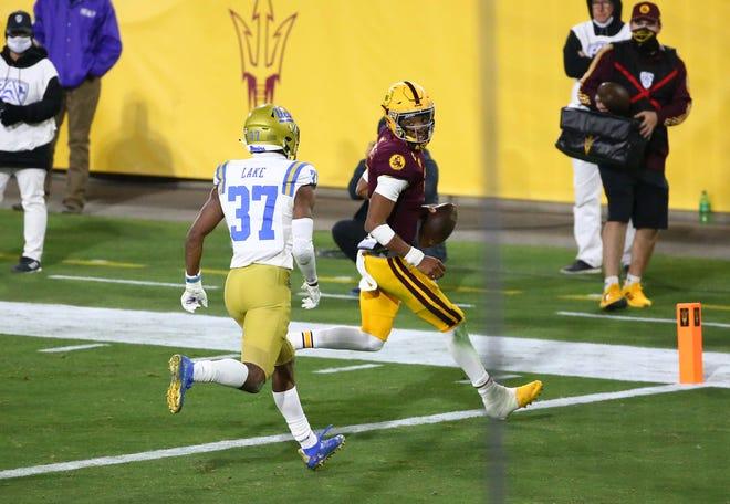 Dec 5, 2020; Tempe, AZ, USA; Arizona State Sun Devils quarterback Jayden Daniels (5) runs for a touchdown past UCLA Bruins defensive back Quentin Lake (37) in the second half during a Pac-12 game at Sun Devil Stadium.