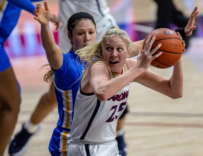 Arizona Wildcats forward Cate Reese (25) evades UCLA Bruins guard Lindsey Corsaro (4) as she moves the ball up court during a game at the McKale Center, on Dec. 4, 2020. Josh Galemore / Arizona Daily Star