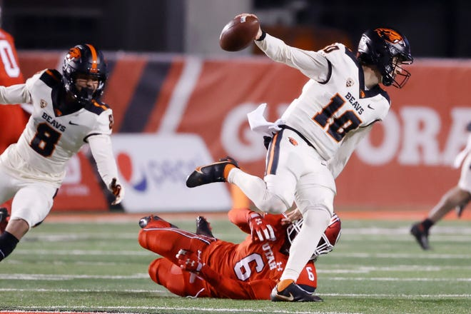 Dec 5, 2020; Salt Lake City, Utah, USA; Oregon State Beavers quarterback Chance Nolan (10) scrambles away from Utah Utes safety Nate Ritchie (6) in the second quarter at Rice-Eccles Stadium. Mandatory Credit: Jeffrey Swinger-USA TODAY Sports